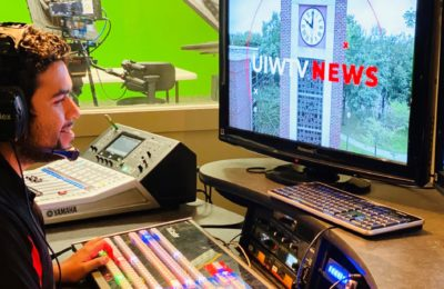 UIWtv student preps for a newscast.